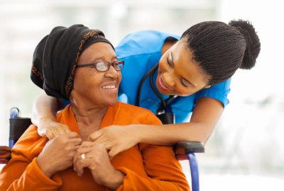 caregiver hugging the elderly woman